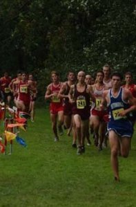 Leading my first collegiate cross-country race as a young cocky 18 year old.